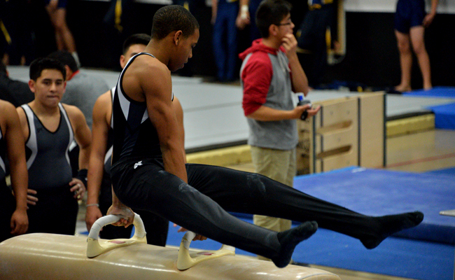 The Gymnastics team competes at its tournament (photo by Rick Cortez).