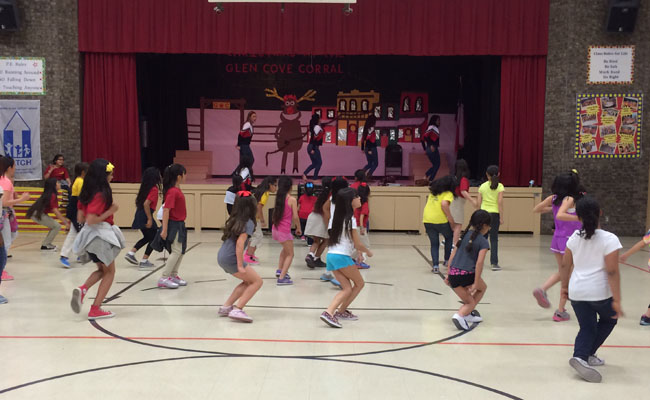 Silhouettes teach elementary students a dance (Photo by Heather Forhan).