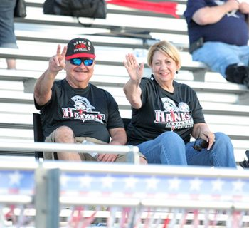 Fans at the football game sit at the opposite side of the press box (photo by Renee Lozano).