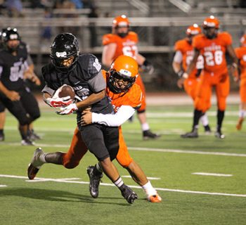 Junior Nick Frayre is tackled by an El Paso High player after picking up a first down (photo by Hanks Media).