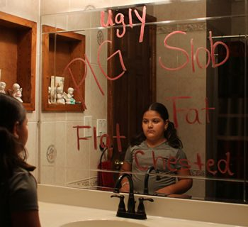 An elementary school student hears the words says about women.  Photo by Miranda Munoz