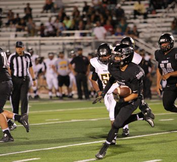 Junior Austin Guerrero scrambles for a first down against Parkland (photo by Daniella Salcido).