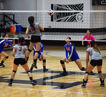 Senior Sandra Sierra goes for the kill against Canutillo (photo by Renee Lozano).