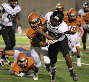 Junior Rashon Peterson fights for a first down against Riverside (photo by Daniella Salcido).