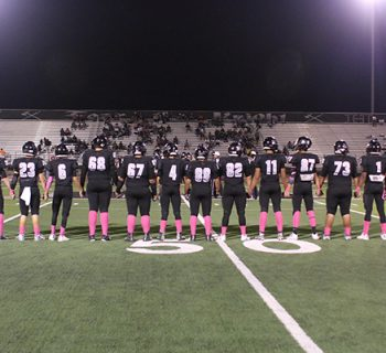 Seniors gather on the field for their last home game. (Photo by Deja McGill)